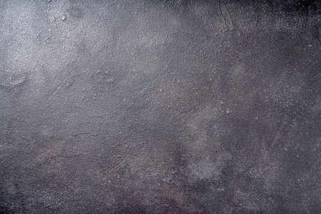 Zwarte betonnen achtergrond bovenaanzicht kopie ruimte
