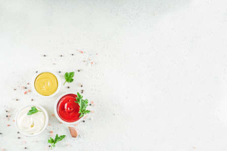 Set of classic sauces on white stone concrete stone background. Stock fotó