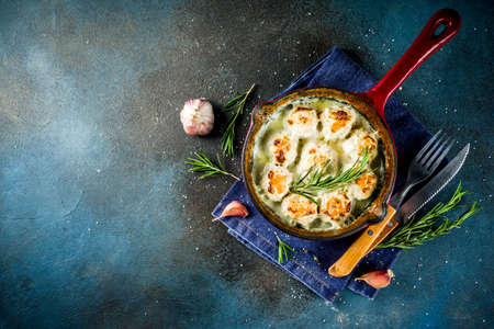 Traditional homemade swedish chicken meatballs in small pan on dark blue wooden background, copy space