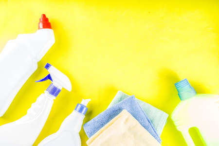 Cleaning concept with different cleaning supplies, on bright yellow background top view, copy space 스톡 콘텐츠