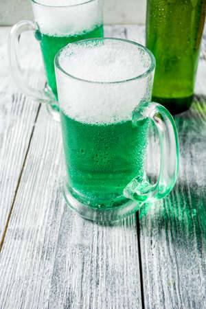 St. Patrick's day concept, two glasses and bottle with cold fresh cold green beer on wooden table, bar counter Background for St. Patrick's day and Oktoberfest menu. Copy space Stok Fotoğraf - 115416084