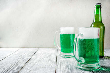 St. Patrick's day concept, two glasses and bottle with cold fresh cold green beer on wooden table, bar counter Background for St. Patrick's day and Oktoberfest menu. Copy space Stok Fotoğraf - 115416085