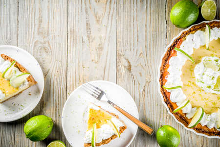 Homemade sweet cake, classic key lime pie with fresh limes, on wooden background copy space Reklamní fotografie