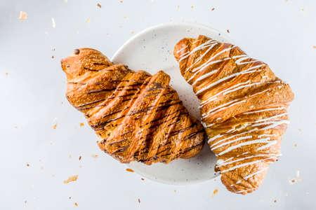Freshly baked croissant on white