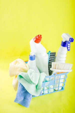 Cleaning concept with different cleaning supplies, on bright yellow background top view, copy space Stock Photo