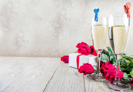 Valentine day concept, Red roses with two champagne glasses, copy space top view