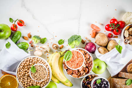 Healthy food. Selection of good carbohydrate sources, high fiber rich food. Low glycemic index diet. Fresh vegetables, fruits, cereals, legumes, nuts, greens. White marble background copy space Stok Fotoğraf - 116433612