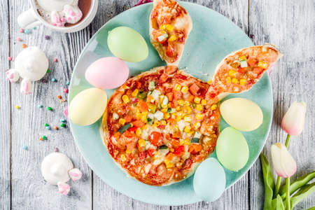 Funny easter food, ideas recipes for children Easter party, healthy  kids pizza with vegetables, top view copy space
