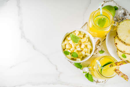 Cold pineapple mojito cocktail with ice, lime and mint, rustic wooden background copy space 版權商用圖片