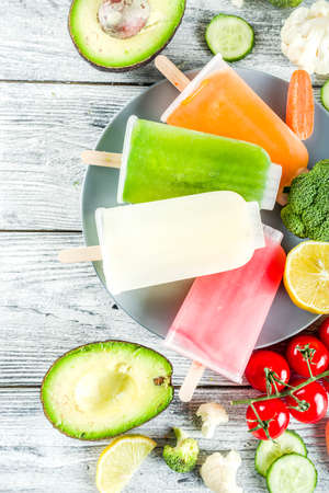 Trendy vegan food, vegetable ice cream  , avocado, cucumber, tomato, beet, carrot, broccoli, cauliflower creamy gelato. Dietary healthy lifestyle, summer cold dessert.