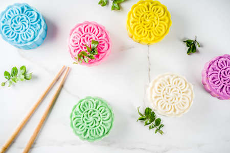 Traditional Chinese Mid-Autumn Festival food, colorful rice cakes snowskin mooncakes with variety of fillings,