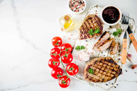 Homemade fresh grilled meat. Grilled bbq beef steak medium with barbeque sauce on wooden board. Top view copy space Reklamní fotografie