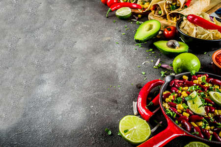 Cinco de Mayo food.Mexican food concept background with taco, quesadilla, burrito, chili, salsa sauce, hot pepper, lime. Black concrete background top view copy space Reklamní fotografie - 118754595