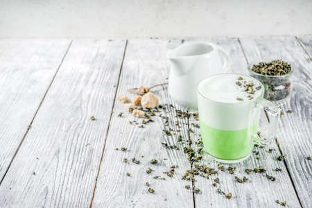 Tea latte, Hot Tokyo Fog Tea Drink with Foamed Milk and Matcha, wooden background copy space Stock Photo
