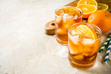 Cold summer cocktail, Iced coffee dink with orange slices, stone table copy space 版權商用圖片
