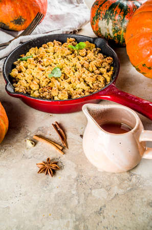 Homemade autumn pastries, pumpkin crumble pie in a cast-iron frying pan, light stone background, copy space top view Stock Photo - 121465790
