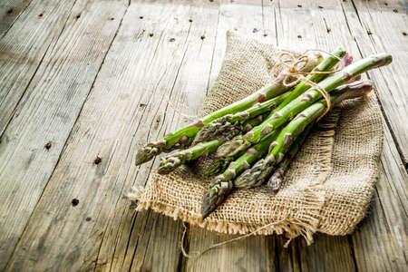 Fresh organic farm asparagus bunch on wooden rustic background