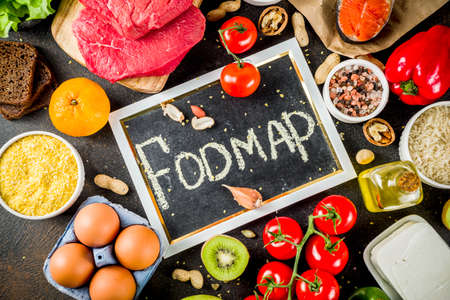 Healthy diet food. Various low fodmap ingredients selection - meat, vegetables, berry, fruit, grains, Trendy healthy lifestyle concept. On dark rusty background copy space top view Фото со стока - 122851043