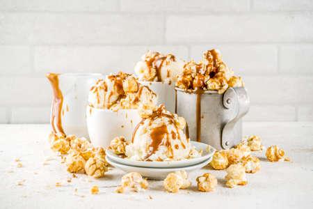 Much of homemade caramel ad pop corn ice cream, on white marble ice cream copy space  Stock Photo