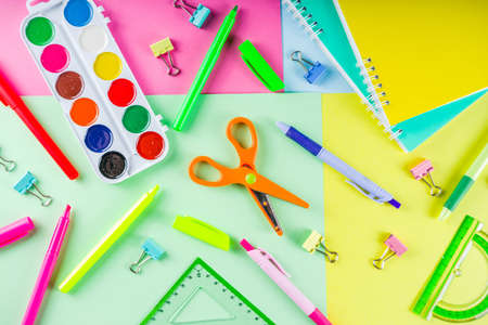 Colorful back to school background. Bright background with school supplies, stationery, pens, pencils, rulers, notebooks, copy space for text, whiteboard for notes, flat lay top view