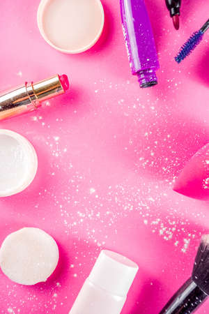 Various make up cosmetic set bright pink background copy space flatlay above