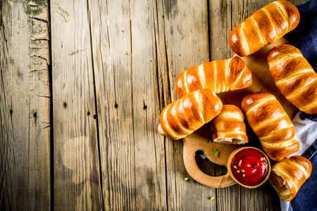 Pretzel wrapped hot dogs with sausages, with ketchup sauce