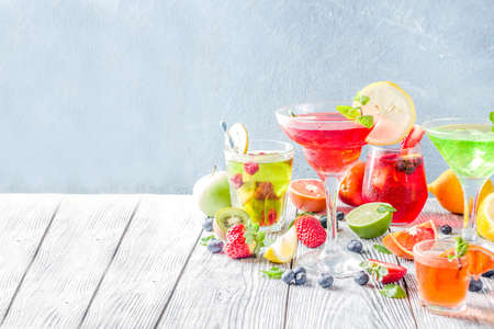 Selection summer fruit and berry cocktail drinks. wooden background copy space 写真素材