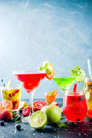 Selection summer fruit and berry cocktail drinks. dark blue background copy space Stock Photo