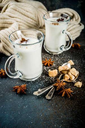 Dutch hot dairy drink Anijsmelk with milk, sugar and aniseed, dark blue rusty background copy space
