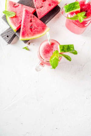 Cold summer drink. Homemade watermelon smoothie. White concrete or stone background copy space Reklamní fotografie - 124514980