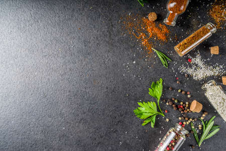 Cooking food background with herbs, olive oil and spices, black stone concrete background above copy space Reklamní fotografie - 124927086