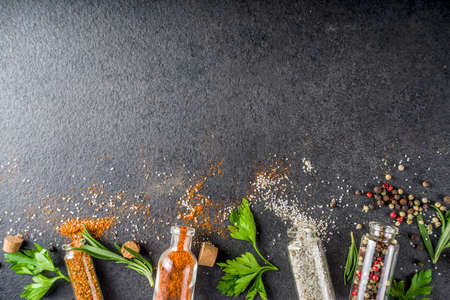 Cooking food background with herbs, olive oil and spices, black stone concrete background above copy space Reklamní fotografie - 124927089