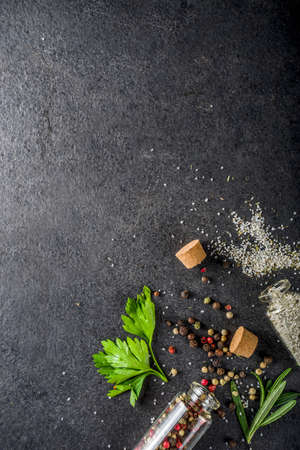 Cooking food background with herbs, olive oil and spices, black stone concrete background above copy space Reklamní fotografie - 124927206