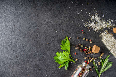 Cooking food background with herbs, olive oil and spices, black stone concrete background above copy space Reklamní fotografie - 124927209