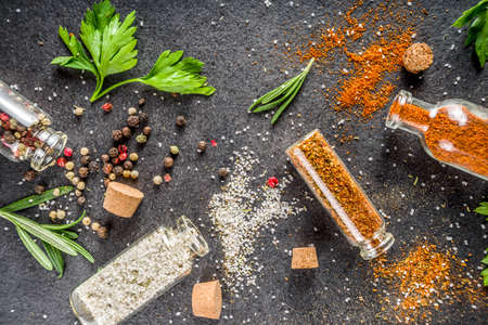 Cooking food background with herbs, olive oil and spices, black stone concrete background above copy space Reklamní fotografie - 124927210
