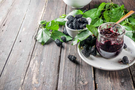 Mulberry Chutney or Jam, with fresh Mulberries, wooden rustic background