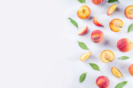 Fresh organic peaches, simple pattern, layout on white background