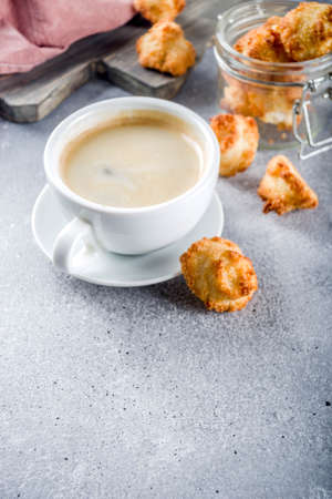 French coconut cookies congolais with coffee mug, grey stone or concrete background copy space 写真素材