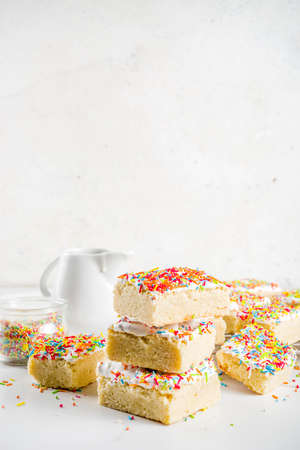 Frosted Sugar Cookie Bars, with sugar topping and colorful sugar crumbles, white marble 写真素材