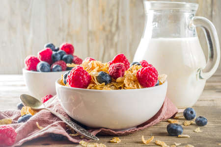 Healthy Corn Flakes for Breakfast with Milk and fresh summer berries