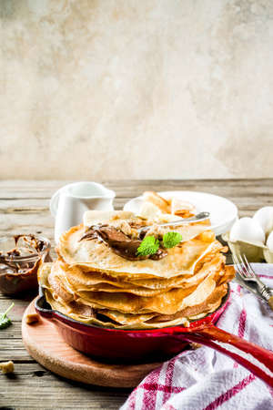 Homemade crepes with chocolate sauce, russian and ukrainian thin pancakes
