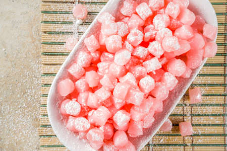 Japanese traditional sweet dessert, pink colored mini mochi Imagens