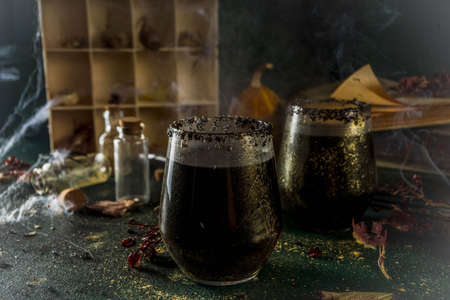 Halloween party drink idea, Witches Brew Black Sangria on Halloween styled table Stock Photo
