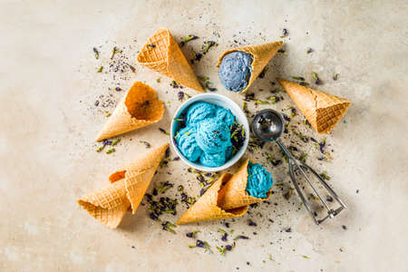 Trendy Color Changing Ice Cream with blue flowers powder, Butterfly Pea Flower Blossom gelato with ice cream waffle cones