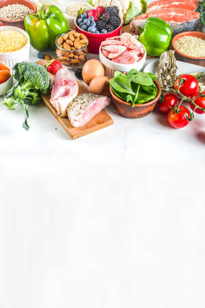 Pescetarian diet plan ingredients, healthy balanced grocery food, fresh fruit, berries, fish and shellfish clams, white marble background copy space  Reklamní fotografie