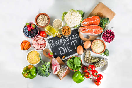 Pescetarian diet plan ingredients, healthy balanced grocery food, fresh fruit, berries, fish and shellfish clams, white marble background copy space  Stok Fotoğraf