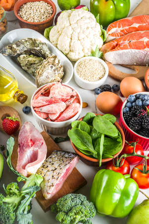 Pescetarian diet plan ingredients, healthy balanced grocery food, fresh fruit, berries, fish and shellfish clams, white marble background copy space