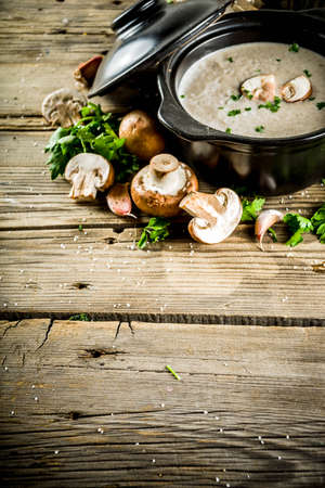 Homemade mushroom soup, old wooden background copy space