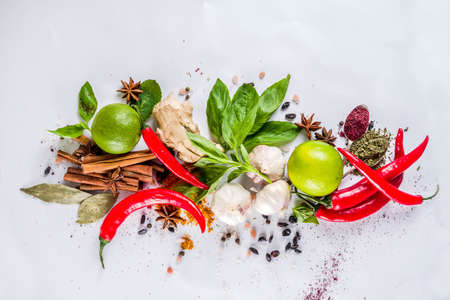 Various herbs and spices on white background top view copy space