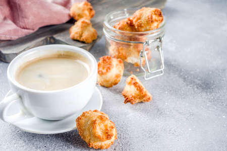 French coconut cookies congolais with coffee mug, grey stone or concrete background copy space Stockfoto